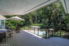 Ornamental aluminum glass railing overlooking backyard