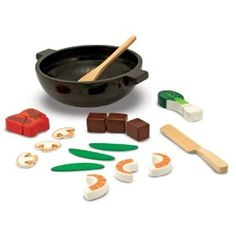 """Your chef can use the wooden knife to cut up lots of meat, red pepper and bok choi and then add it to the shrimp, mushrooms, and snow peas, stir-frying in the non-stick wooden wok from Melissa and Doug. Loop and hook chopsticks are handy for stirring and serving!   Dimensions: 3.25"""" x 8.5"""" x 10"""" Packaged.     Recommended Ages: 3+ years old. $16.78"""