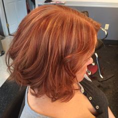 Red copper hair base with deep burgundy and bright red lowlights and honey highlights on a freshly cut lob.  So gorgeous!  No bayalge, strictly foils.