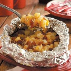 Grilled Triple Cheese Potatoes! - Toss it all in foil and grill it next to the burgers on Memorial Day :)