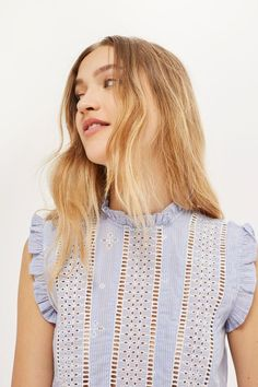 Inject a dose of bohemia to your look with this broderie stripe sleeveless top. With ruffle trims to the neck and sleeves, this girly style is perfect paired with jeans or dressed up with vivid trousers.