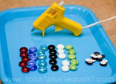 Make circular colored magnets with gems, circular magnets, and a glue gun.