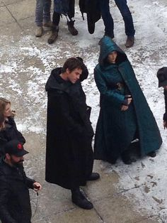 SET PHOTOS: Katniss and gale I'm guessing in the Capitol cause it looks like they're in disguise ;)
