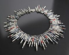 paper necklace, made from tightly rolled magazines and then varnished to a high gloss.