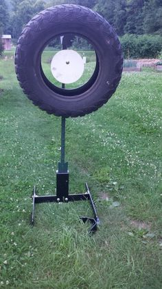 Tire mounting kit mounts on the T post over the target plate. Bullet fragments are safely captured in the tire for disposal Shooting Targets, Shooting Sports, Shooting Gear, Shooting Bench Plans, Shooting Table, Diy Archery Target, Bow Target, Range Targets, Steel Targets