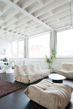 Modern Interior Design With Legandary Togo Sofa And Playful Bubble Chair