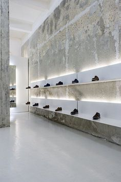 This shoe shop is located in an old building from 60s. I clearly wanted to keep the true and beautiful to me structure, revealed after complete stripping of the numerous layers created over the years. Deliberate emphasis on architectural axes...