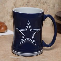 Dallas Cowboys 15 Ounce Sculpted Logo Relief Coffee Mug by Boelter. $14.95. For the truly devoted fan, we are proud to present this officially licensed Dallas Cowboys coffee mug from Boelter Brands. Now you can brighten up your office or home with your favorite NFL team's colors and logo while you enjoy your favorite beverage. The 15-ounce ceramic mug features a 3-D sculpted relief logo on each side, plus the team name printed on the handle. Perfect for coffee, tea, or whatever y...