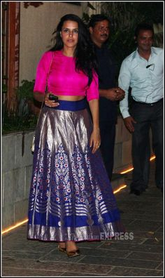Neha Dhupia in Sanjay Garg Neha Dhupia also sports the rich fabrics of Sanjay Garg but with a blue and silver skirt and contrast plain hot pink 3/4 sleeve blouse and dresses it up with some heels. It works! Indian wedding - Bollywood wedding #thecrimsonbride