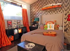Small but cheerful teenage boy's bedroom with bright orange accent details