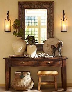How to decorate your home using console table decor and vignettes to add character to your home! All different styles showcased Tuscan Shabby chic eclectic Rustic Entry table decorating decor. TRY TESE CANDLE HOLDERS IN THE BASEMENT ROOM. Home Living, Living Room Decor, Dining Room, Dining Chairs, Entryway Decor, Wall Decor, Pottery Barn Entryway, Entryway Ideas, Pottery Barn Table