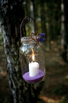 Mason Jars with Citronella votive candles..Perfect for an outdoor wedding. love the colored sand. I've been personally collecting glass jars (from pasta sauce/candles...) for ideas like this for my future Wedding :) -RP