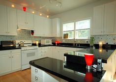Granite Transformations Project Showing Recycled Trend Glass Countertops  And Hand Cut Trend Mosaic Karma Tiles With