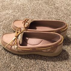 Gold Sperry's Sparkly gold Sperry top-sider shoes. In GREAT condition as pictures show, only worn 2 times. I'm willing to trade selectively for other name brand shoes size 8. Sperry Top-Sider Shoes