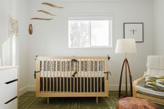 Baby nursery inspiration Reveal from Puj. Love the wood mobile. Stylish baby rooms are all about attention to detail.