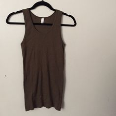 Dark green tank top by American Apparel Dark green tank top from American Apparel. Tag says XL but fits more of a s/m. Never worn but had been washed once. American Apparel Tops Tank Tops