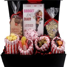 "Great Xmas gift idea - This great ""chick flick movie night in"" gift box hamper comes with a choice of 7 DVDs and is filled with lots of nostalgic sweets, including cola bottles, pink shrimps, sour tongues, black jacks, fruit salads and bon bon's. As well as the fab pic n mix there is a delicious slice of chocolate pizza and chocolate drizzle popcorn"
