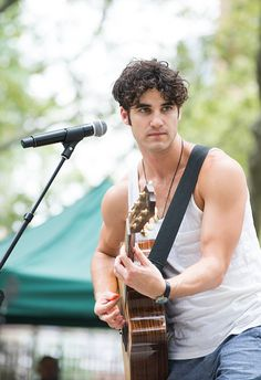 | NEW YORK, NY - JULY 15: Darren Criss performs during Broadway In The Boros' at Fort Greene Park Brooklyn on July 15, 2016 in New York City.