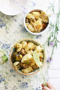 Yummy Mummy Kitchen: Baked Brussels Sprout Mac and Cheese - The recipe actually makes a lot of healthy substitutions too - but I might be a little more apt to throw some real butter in there.