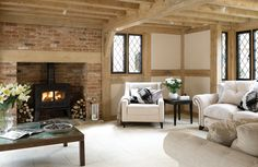 I would love a cosy cottage eventually with wooden beams, bricks and an open fire :)