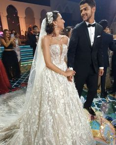 """LEBANESE WEDDINGS on Instagram: """"EVERYTHING about this wedding 🥰 from the customized entrance song, to the epic wedding vibes, and the larger than life cake, we are in LOVE…"""" Entrance Songs, Lebanese Wedding, Wedding Videos, Wedding Moments, Videography, Larger, Weddings, Bride, Wedding Dresses"""