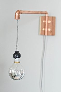 DIY Copper Pipe Wall Sconce | Claire Zinnecker for Camille Styles I am thinking of this with a different style bulb/shade possibility
