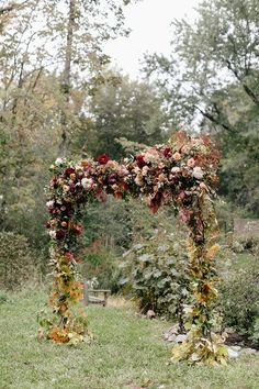 floral ceremony arch - photo by Emily Wren Photography http://ruffledblog.com/a-burgundy-lovefest-that-youll-have-to-see-to-believe