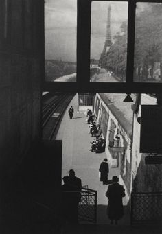 Harris watching from the shadows of Paris with Eiffel Tower in distance- 1929 by André Kertész