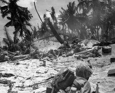 Wave of marines hitting the beach at Tarawa 1943