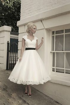 Mooshki Bridal Kathryn Dress Calf length tulle and lace wedding dress with lace bodice and key hole back and cap sleeves