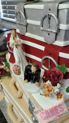 Figurines were supplied by the bride. Flowers were made with fondant.