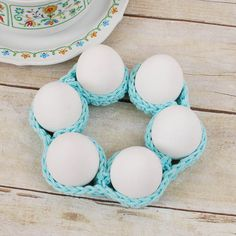 Create a nice egg display with this cute egg cozy by @petalstopicots