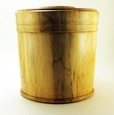 Turned Box in Spalted Maple - Item 289. This is a large lidded box turned from a piece of spalted Maple wood. It has nice beaded details and is finished with beeswax and buffed to a beautiful satin sheen. It measures 5-3/4″ round and is 6″ tall. It would make a wonderful cremation urn for a pet, or a great place to keep tobacco or other special things.