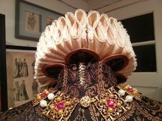 Backside of a 16th Century Spanish style ruff,  supported by tabbed wings with metal wire inside,  stitched to the collar.  Costume and ruff made by Angela Mombers