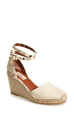 Free shipping and returns on Valentino 'Rockstud' Wedge Espadrille Sandal (Women) at Nordstrom.com. Pyramid studs boldly detail a warm-weather favorite in lavishly textured leather. Valentino's espadrille wedge features braided jute detailing for a breezy, ever-chic finish.