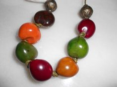 This is a lovely necklace made of hawaiian kukui nuts. They are autumnal colours of burgundy, burnt orange, light brown, dark brown and green. They are knotted on to greek leather cord and finished with an antique bronze clasp. Leather Cord, Burnt Orange, Hawaiian, Seeds, Burgundy, Christmas, Xmas, Navidad, Noel
