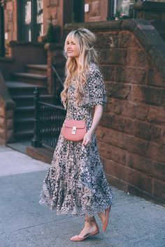 Love this whimsical look - flowing printed dress with a long bohemian hairstyle, ballet flats, and a pink cross body