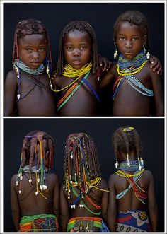 Africa |  Mwila tribe children - Angola. Those little girls from the Mumuhuila tribe live near Chibia, in the south of Angola. They wear the traditional hairstyle and the big necklace. The necklace shows if they are teens or not. They still are children as the necklace is simple, with beads. | © Eric Lafforgue