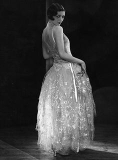 c1929: A model wearing a Norman Hartnell evening gown. (Photo by Sasha via Getty Images)
