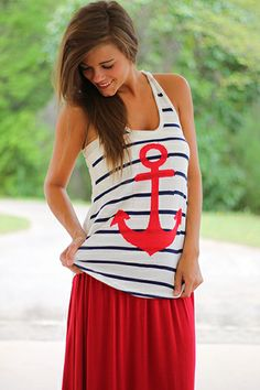"""The anchor trend has set sail and we are 100% on board! This tank features an AHHdorable big, red anchor on a background of navy and white stripes! Doesn't it pair well with out Easy Rider Maxi skirt in red!? :) Fits true to size. Miranda is wearing the small. Shoulder to hem: S - 26.5"""" M - 27"""" L - 27.5"""""""