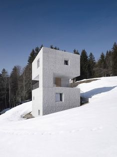 Roughly hewn concrete gives a rocky texture to the walls of this Alpine holiday home by Austrian studio Marte.Marte Architects.
