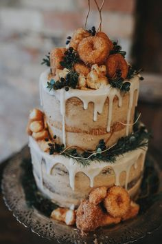 The Hottest Trend in Wedding Desserts: Drip Cakes | Icing + Crumb Donut Forest Cake // boho bride wedding cake alternative with donuts
