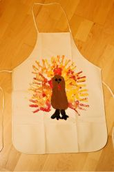 Ooooohh!  Gonna make these with the grandkids! Thanksgiving aprons they can wear as they help me serve at the Thanksgiving Feast!  Use a child's shoe for the body of the turkey & handprints for the feathers.  Need plain canvas aprons and fabric paint in fall colors.  FUN!