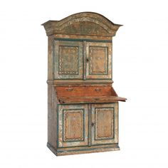 This is a late 18th century Swedish bureau cupboard.  The cupboard has been dry scraped which has revealed charming original and decorative paint work  199cm high, 116cm wide and 54cm deep