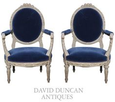 A Pair Of French Louis XVI Style Open Arm Chairs
