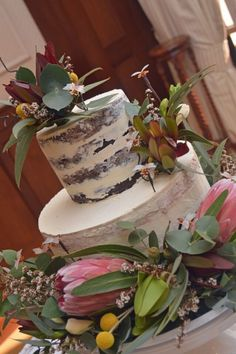 Dreamy naked cake decorated with native Australian flowers and greenery. Boho rustic - Dream Cakes and Creations | Queensland Brides