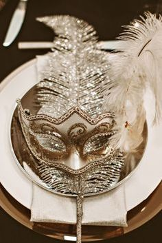 A mask at each table setting for a New Year's wedding