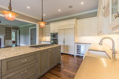 Custom Cabinets in this island by Pritchard Cabinets. Island Countertop is Windermere Cambria with Dupont Edge with kitchen perimeter in 3cm Ceasar Stone Ginger.