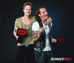 Brian Kelley and Tyler Hubbard of Florida Georgia Line celebrate their win at Wonderwall.com's portrait studio backstage at the 2014 CMT Music Awards in Nashville, Tenn., on June 4, 2014.