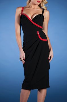 Loving the red accents on this dress. Retro feeling with a bit of  sultry temptation